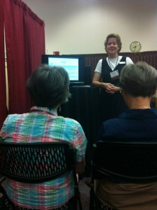 Jill Crandell giving demos at ResearchTies booth